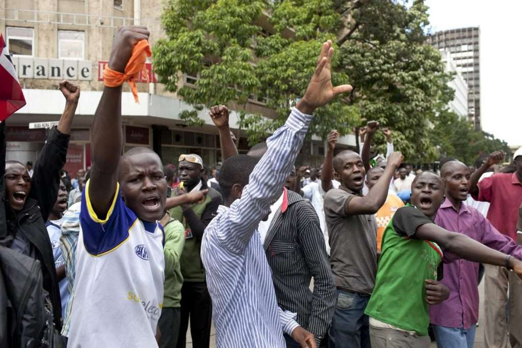 Supporters of Odinga, Kenya's then-prime minister and a presidential candidate, stage a protest outside the Supreme Court in 2013, after the justices said the election results were valid and Kenyatta won.