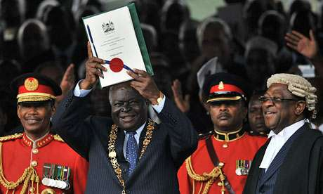 President Kibaki Holding up the Constitution of Kenya 2010
